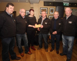 Paula Keeney receives a cheque on behalf of Donegal Down Syndrome for E3250 from Midwest Donegal Vintage Club members, Daniel Moy, William Payne, Aaron O'Shea, Eddie Boyd and Brendan Byrne.(jmac.ie)